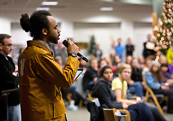 Chris Jordan '15, poses a question to the panel during a forum discussion of issues surrounding deaths of African-Americans by police and is sponsored by the Diversity Center, Women's Center and CCES held in the Scandinavian Center at PLU on Thursday, Dec. 4, 2014. (PLU Photo/John Froschauer)