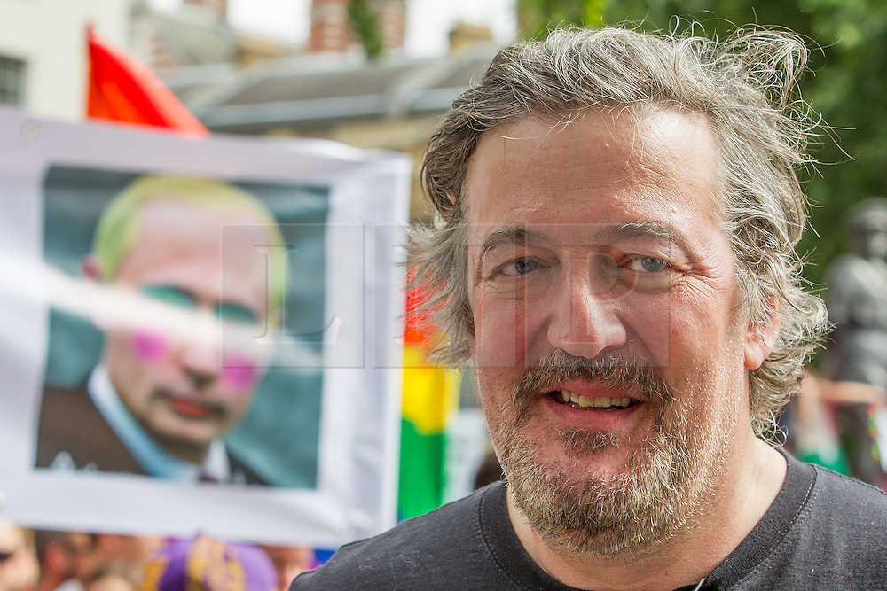 "© Licensed to London News Pictures . 10/08/2013 . London , UK . STEPHEN FRY at the demonstration . Protesters with placards . Demonstration against homophobic laws being enacted in Russia on Whitehall this afternoon (10th August 2013) . Legislation includes banning gay pride events for100 years , banning the distribution of "" propaganda of non-traditional sexual relations "" to minors , making it illegal for the adoption of Russian children by gay couples or any single person who comes from a country that recognises marriage equality and giving authorities the rights to arrest foreign nationals whom they suspect are LGBT or pro gay with the right to detain them for up to 14 days. Photo credit : Joel Goodman/LNP"