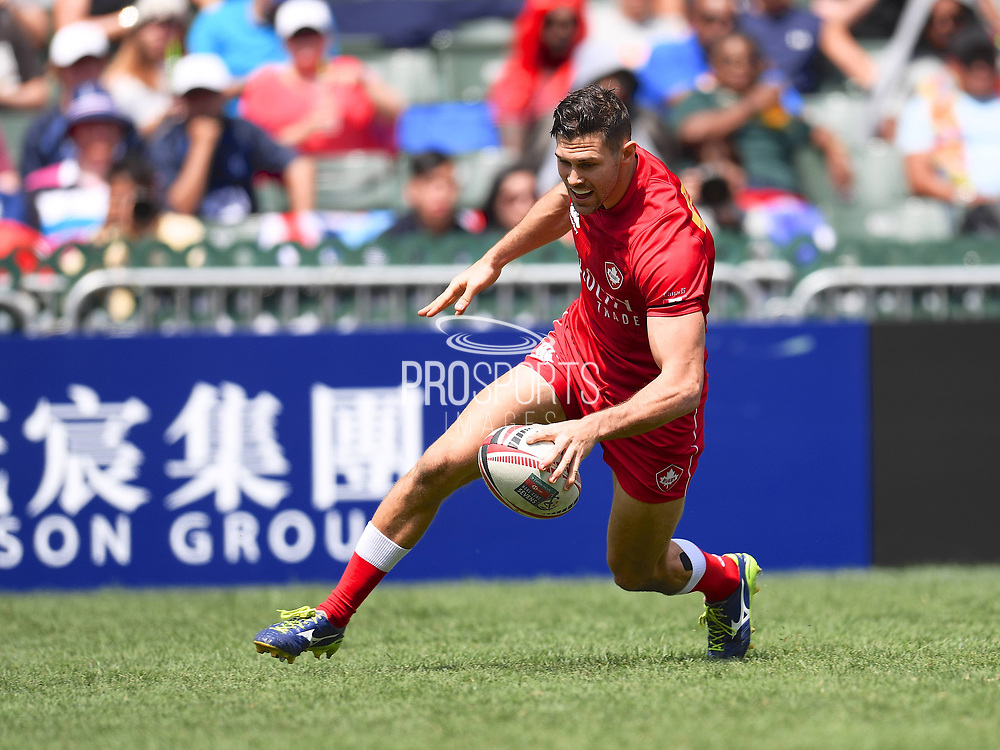 Canadian player Justin Douglas scores a try in the game Canada vs South Kores during the Cathay Pacific/HSBC Hong Kong Sevens festival at the Hong Kong Stadium, So Kon Po, Hong Kong. on 8/04/2018. Picture by Ian  Muir.
