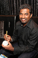 Muttiah Muralitharan signs a cricket ball for a fan during the official launch press conference and party for the Airtel Champions League T20 tournament (being held in South Africa in September 2010) held at Taboo nightclub in Sandton, Johannesburg on the 10 August 2010..Photo by..CLT20 / SPORTZPICS