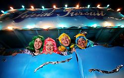 23 Feb 2006. New Orleans, Louisiana. <br /> Loading up and clambering on board a float with The Krewe of Muses. Muses is the only all women's Krewe to parade in New Orleans and is known for its satire, famous shoe throws and is generally considered one of the most popular parades of the Mardi Gras.  Women load up on their floats ready for the parade.<br /> Photo © Charlie Varley/varleypix.com