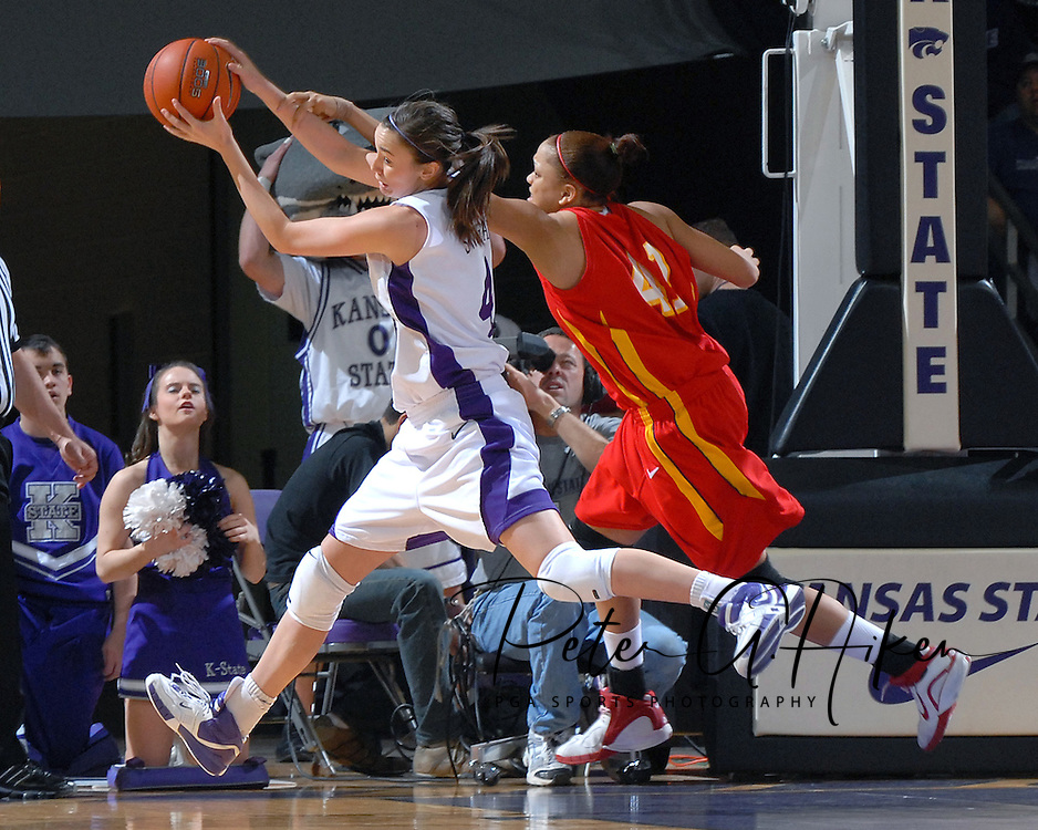 Kansas State forward Ashley Sweat (L) pulls a rebound away from Iowa State's Toccara Ross (R), during first half action at Bramlage Coliseum in Manhattan, Kansas, February 24, 2007.  Iowa State beat K-State 64-61.