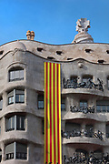 Catalan flag, celebrating catalan nationalism, draped on the Casa Mila, or La Pedrera building designed by Antoni Gaudi and built 1906-12, on Diada, or La Diada Nacional de Catalunya, Catalonia's National Day, on 11th September 2018, Barcelona, Catalonia, Spain. 2018 saw the largest Diada march ever, organised by the Catalan National Assembly, with a million people taking to the streets, supporting secession and the reinstatement of the unrecognised Catalan Declaration of Independence after the referendum of 2017. Picture by Manuel Cohen