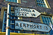Street signs in Gaelic and English point the direction to Cork, the Airport and Gelgooly in County Cork, Ireland