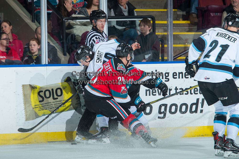 KELOWNA, CANADA - DECEMBER 2: Conner Bruggen-Cate #20 of the Kelowna Rockets checks Jonathan Smart #10 of the Kootenay Ice into linesman Dustin Minty during first period on December 2, 2017 at Prospera Place in Kelowna, British Columbia, Canada.  (Photo by Marissa Baecker/Shoot the Breeze)  *** Local Caption ***