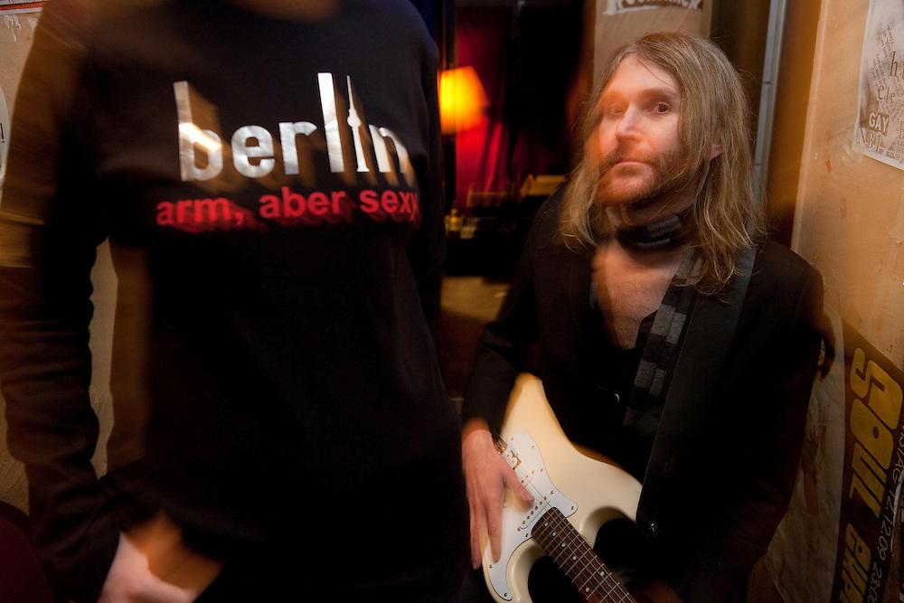 "Germany - Deutschland - BERLIN - ""Arm aber sexy"", ""Poor but sexy"" (quote Klaus Wowereit / Major) HERE: 8mm Bar; woman with T-Shirt & musician LOUIS St. LOUIS, Berlin-Prenzlauer Berg, 21.01.2010; copyright > Christian Jungeblodt"