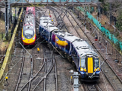 Scotrail passenger train and Virgin Trains train and tracks at  Waverley Station in Edinburgh, Scotland, United Kingdom
