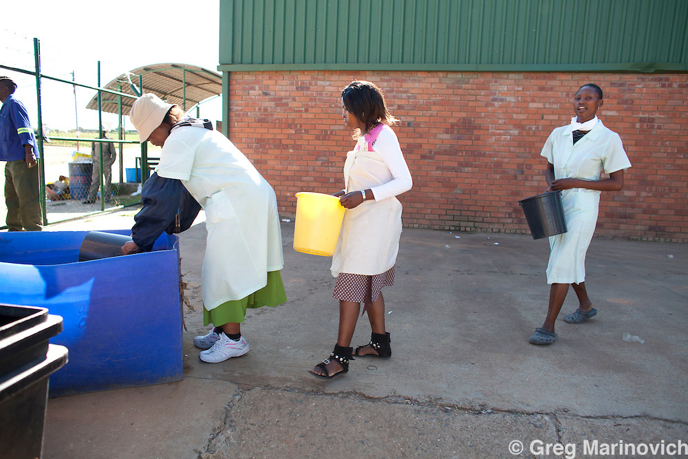 Maputsoe, Lesotho, January 27, 2012. The Ace Apparel clothing factory in the industrial zone of Maputsoe where the owners say they only have water about two thirds of the time, and they have to get potable ater in drums for staff drinking and washing, as well as for steaming the clothes that are all for the South African market. The water for the toilets is collected by bucket from a trough of dam water. This particular factory employs 900 people. The inability to supply water to a designated industrial area that is essential to Lesotho's economy - even factories such as these cut and sew ones where they do not use the water intensive laundry process, is puzzling. Greg Marinovich / Storytaxi