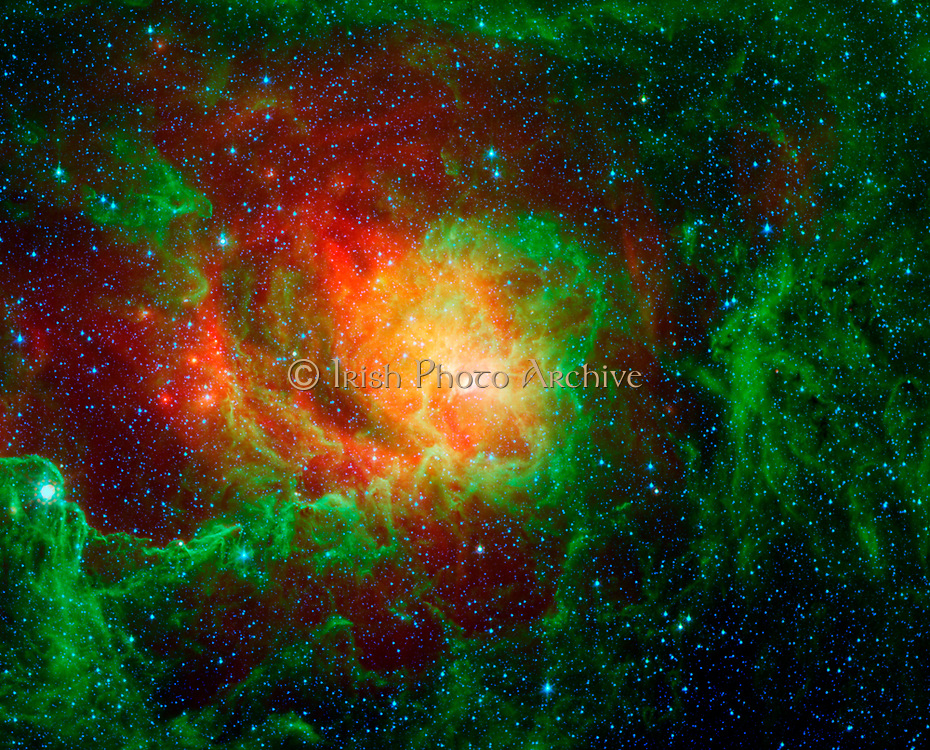 Swirling dust clouds and bright newborn stars dominate the view in this image of the Lagoon nebula from NASA's Spitzer Space Telescope. Also known as Messier 8 and NGC 6523, astronomers estimate it to be between 4000 and 6000 light years away, lying in the general direction of the center of our galaxy in the constellation Sagittarius.