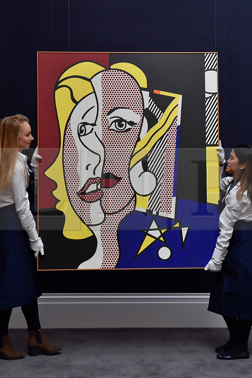 "© Licensed to London News Pictures. 06/10/2017. London, UK. Technicians present ""Female Head"", 1977, by Roy Lichtenstein at a preview at Sotheby's in New Bond Street of contemporary, impressionist and modern art works to be auctioned in New York in November 2017 Photo credit : Stephen Chung/LNP"