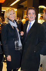 """MISS REBECCA HOWARD and MR RORY VERE NICOLL at a party to celebrate the opening of the new Mont Blanc store at 151 Sloane Street, London on 9th March 2005.  The evening was held in conjunction with UNICEF's """"Sign up for the right to write"""" campaign which is raising money though the sale of celebraties 'statements' currently for auction on the ebay website.<br /><br />NON EXCLUSIVE - WORLD RIGHTS"""