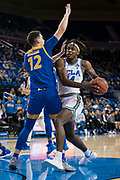 San Jose State Spartans forward Eduardo Lane (12) gets called for a blocking foul against UCLA Bruins forward Jalen Hill (24) during an NCAA college basketball game, Sunday, Dec. 1, 2019, in Los Angeles. UCLA defeated San Jose State 93-64. (Jon Endow/Image of Sport)