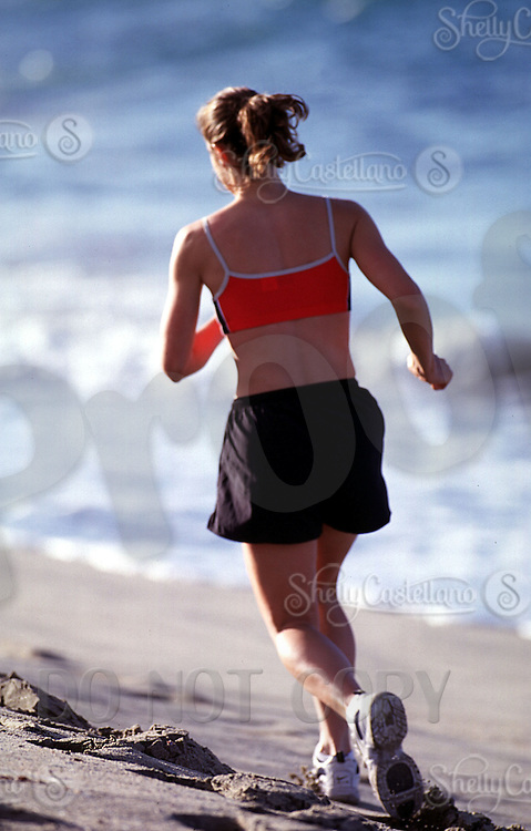 2 April 2003: 25 year old female model Andrea Wilson, goes for an early morning jog and workout run in the sand at the beach to stay in shape and maintain fitness.