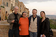Peter Menzel and Faith D'Aluisio visit with Daniela Ciolfi and Fabio Pellegrini. Revisit with the Pellegrini family, 2005, Pienza, Italy. The Pellegrinis were Italy's participants in Material World: A Global Family Portrait, 1994 (pages: 198-199), for which they took all of their possessions out of their house for a family-and-possessions-portrait. In 1996, UNESCO declared the town a World Heritage Site.