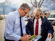 "07 APRIL 2019 - DES MOINES, IOWA:  Rep. TIM RYAN, (D-OH) autographs a photo of the White House for a man before Ryan's first Iowa campaign event of the 2020 caucus season. Ryan declared his candidacy on the US television show ""The View"" on April 4. Ryan, 45 years old, represents Ohio's 13th District, which includes Lordstown, where a large General Motors plant recently closed. He is the latest Democrat to announce his candidacy to be the Democratic nominee in the 2020 election. Iowa holds its presidential caucuses on Feb. 3, 2020.   PHOTO BY JACK KURTZ"
