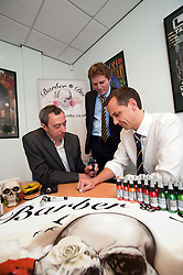 Managaing Director of Barber (DTS) Of Sheffield Ltd Tony Crane ( left) explains the uses of some of the Tattooing equipment supplied by his company   to Investors Wayne Thomas EV group and Andy Dodd of PHD ..16  May 2012.Image © Paul David Drabble