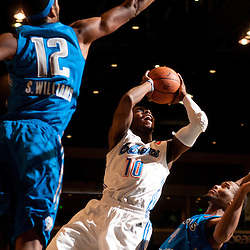 RENO, NV - JANUARY 10:  Dwight Buycks #10 of the Tulsa 66ers shoots between defenders Sean William #12 and Vance Cooksey #4 of the Texas Legends during the 2012 NBA D-League Showcase inside the Reno Events Center in Reno, Nev., Tuesday, Jan. 10, 2012.  NOTE TO USER: User expressly acknowledges and agrees that, by downloading and or using this photograph, User is consenting to the terms and conditions of the Getty Images License Agreement. Mandatory Copyright Notice: Copyright 2012 NBAE  (Photo by David Calvert/NBAE via Getty Images) *** Local Caption *** Dwight Buycks;Sean Williams;Vance Cooksey