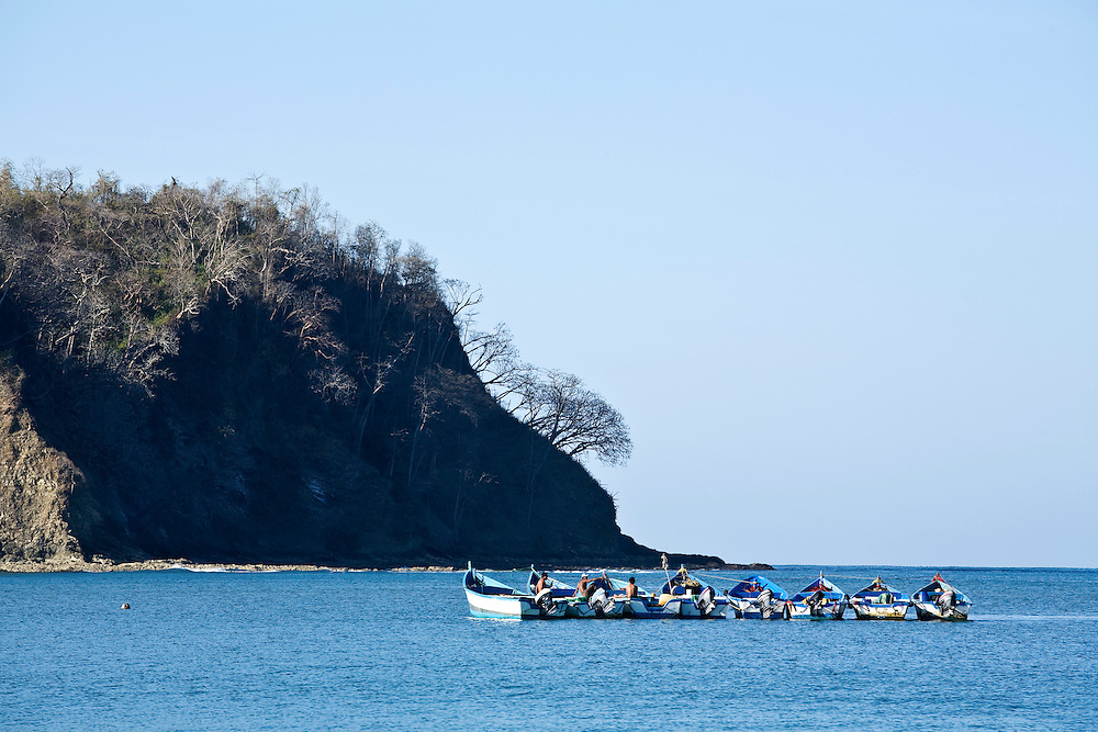 Fishing boats anchored off the beach of Samara in southern Guanacaste