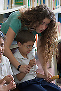"Teaching basic rythm and tonality to kids. Jose? Marti? Bolivarian school at the Barrio Sarria, one of Caracas' poor quarters, is home to the ""Nucleo Sarria of the ""Fundacion del Estado para el Sistema Nacional de las Orquestas Juveniles e Infantiles de Venezuela"" (FESNOJIV, National Network of Youth and Children Orchestras of Venezuela). This organization is also known as El Sistema, is a publicly financed private-sector music-education program in Venezuela, originally called Social Action for Music, founded 1975 by Venezuelan economist and amateur musician Jose? Antonio Abreu."