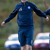 St Johnstone Training...<br /> Left back Brian Easton warms up during training<br /> Picture by Graeme Hart.<br /> Copyright Perthshire Picture Agency<br /> Tel: 01738 623350  Mobile: 07990 594431
