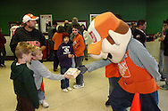 A fan gets a gift from Homer from Home Depot before the Dayton Gems take on the Flint Generals at Hara Arena, Sunday, November 22, 2009.