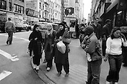 Three Muslim woman at a street corner waiting to cross the street.  New York is such a melting pot, I love it.