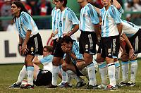 25/07/04 - LIMA - PERU -  COPA AMERICA PERU 2004 -  BRASIL - BRAZIL (5) win by penalty  over ARGENTINA (3) - Argentine deception - fROM LEFT TO RIGHT - juan pablo sorin AND JAVIER MASCHERANO.<br />©G.P./Argenpress.com