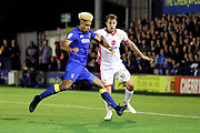 AFC Wimbledon striker Lyle Taylor (33) about to shoot during the EFL Sky Bet League 1 match between AFC Wimbledon and Milton Keynes Dons at the Cherry Red Records Stadium, Kingston, England on 22 September 2017. Photo by Matthew Redman.