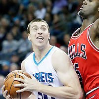 03 November 2015: Charlotte Hornets forward Tyler Hansbrough (50) drives past Chicago Bulls forward Bobby Portis (5) during the Charlotte Hornets  130-105 victory over the Chicago Bulls, at the Time Warner Cable Arena, in Charlotte, North Carolina, USA.