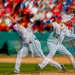 Mar 8, 2013; Melbourne, FL, USA; A multiple exposure image of Washington Nationals relief pitcher Patrick McCoy (62) throwing against the St. Louis Cardinals during the top of the eighth inning of a spring training game at Space Coast Stadium. Mandatory Credit: Derick E. Hingle-USA TODAY Sports