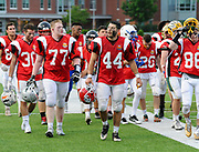 South Squad's Eli Peters (77), from Duxbury High School, leaves the field with teammates during half time of the Shriner's All-Star Football Classic at Bentley University in Waltham, June 22, 2018.   [Wicked Local Photo/James Jesson]