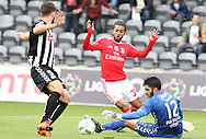 Benfica's player Carcela (C ) fights for the ball with Nacional´s goalkeeper Rui Silva   (R ) during Portuguese First League football match Nacional vs Benfica  held at Madeira Stadium, Funchal, 11 January 2016.  LUSA / GREGORIO CUNHA