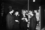 05/01/1965.01/05/1965.5th January 1965.The Aer Lingus Young Scientist Exhibition at the.Manson House..Aer Lingus Hostess Anne Tolan and Ann O'Connor  and prize winner Patrick Henehan (Blackrock College) listen to Edward McCarthy (St. Finbarr's College Cork) who won a 2nd prize in senior physics section, explaining his project