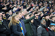 AFC Wimbledon fans pointing during the The FA Cup 3rd round match between Tottenham Hotspur and AFC Wimbledon at Wembley Stadium, London, England on 7 January 2018. Photo by Matthew Redman.