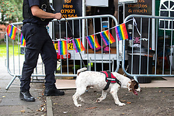 © Licensed to London News Pictures . 25/08/2017. Manchester , UK. Police search team with explosive search dog in the Gay Village on the opening night of Manchester Pride's Big Weekend . The annual festival , which is the largest of its type in Europe , celebrates LGBT life . Photo credit: Joel Goodman/LNP