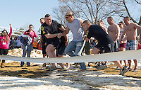 "Sgt Gary Hubbard (Left) and Patrolman Ben Black (right) take their ""fugitive"" Chief Christopher Adams into Lake Winnipesaukee for the annual Winni Dip for Special Olympics on Sunday afternoon at the Margate Resort.  (Karen Bobotas/for the Laconia Daily Sun)"