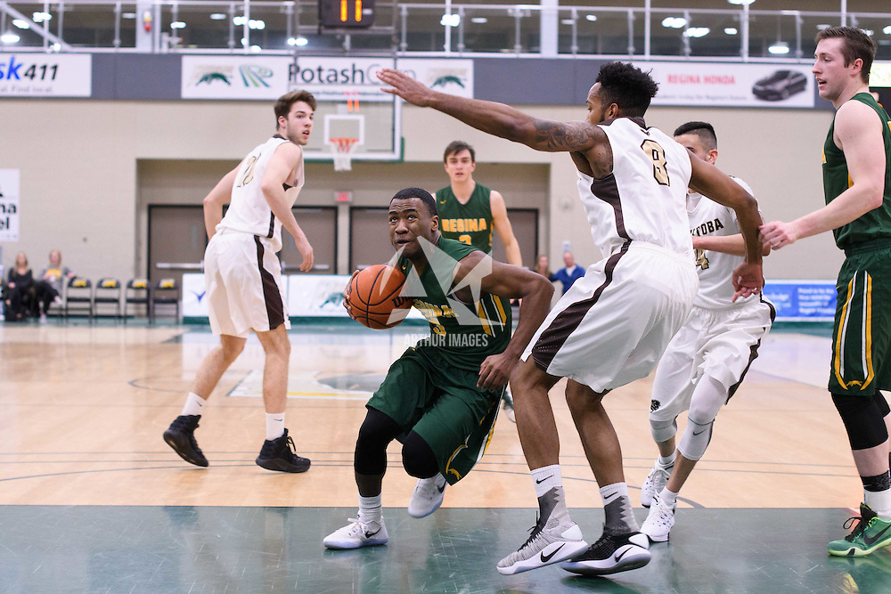 1st year guard Johneil Johnson (3) of the Regina Cougars in action during the home game on January  14 at Centre for Kinesiology, Health and Sport. Credit: /Arthur Images