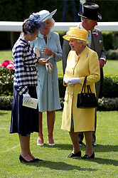Her Majesty The Queen (right), The Duchess of Cornwall (centre) and Anne, Princess Royal (left) in the parade ring during day two of Royal Ascot at Ascot Racecourse.