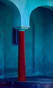 Red Pillar and blue wall.