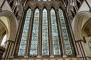 "The Five Sisters Window in the North Transept of York Minster is the only memorial in the country to women of the British Empire who lost their lives during the First World War. The window, which dates from the mid-1200s, was restored and rededicated between 1923 and 1925 after it was removed during the First World War to protect it during Zeppelin raids. York Minster, built over 250 years 1220-1472 AD, is one of the finest medieval buildings in Europe. Also known as St Peter's, its full name is ""Cathedral and Metropolitical Church of St Peter in York,"" located in England, United Kingdom, Europe. York Minster is the seat of the Archbishop of York, the second-highest office of the Church of England. ""Minster"" refers to churches established in the Anglo-Saxon period as missionary teaching churches, and now serves as an honorific title. York was founded by the Romans as Eboracum in 71 AD. As the center of the Church in the North, York Minster has played an important role in great national affairs, such as during the Reformation and Civil War."