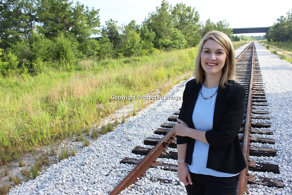 RAY VAN DUSEN/BUY AT PHOTOS.MONROECOUNTYJOURNAL.COM<br /> Monroe County Chamber of Commerce Executive Director Chelsea Baulch stands at the end of a railspur expansion at Amory Port South. Developing industrial sites countywide is one of her preliminary goals with her new position.