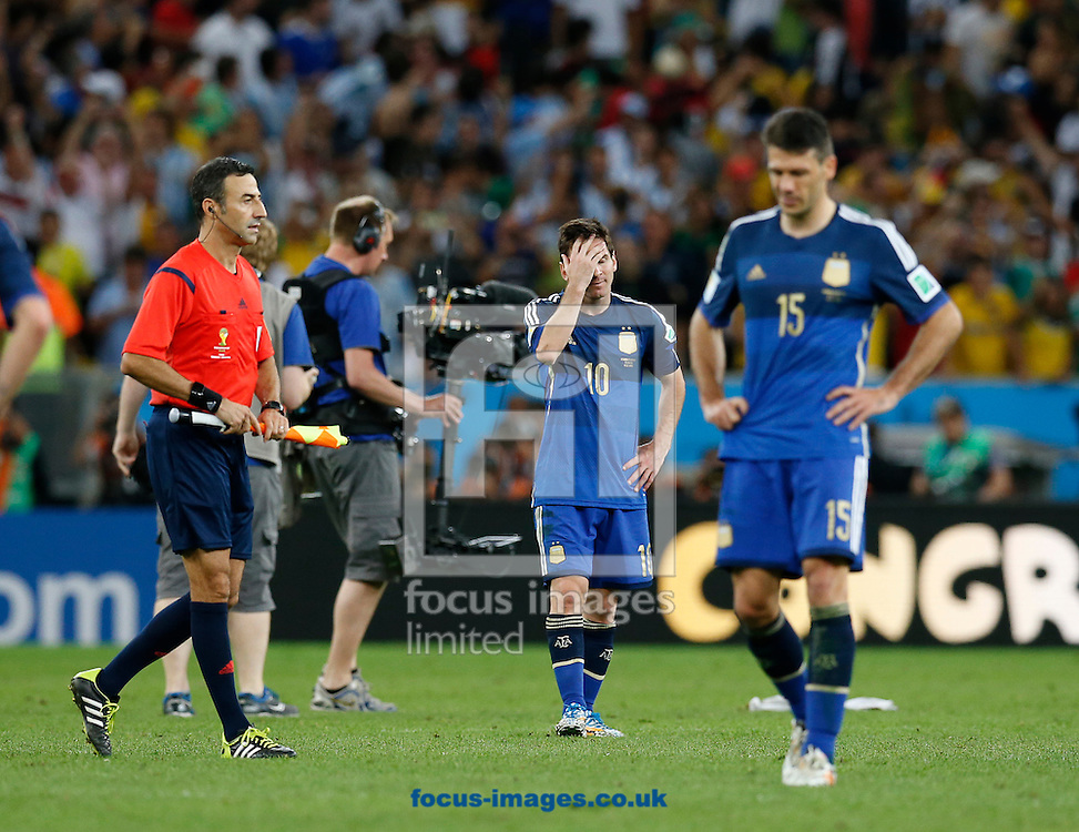 Argentina's Lionel Messi shows dejection at the end of the 2014 FIFA World Cup Final match at Maracana Stadium, Rio de Janeiro<br /> Picture by Andrew Tobin/Focus Images Ltd +44 7710 761829<br /> 13/07/2014