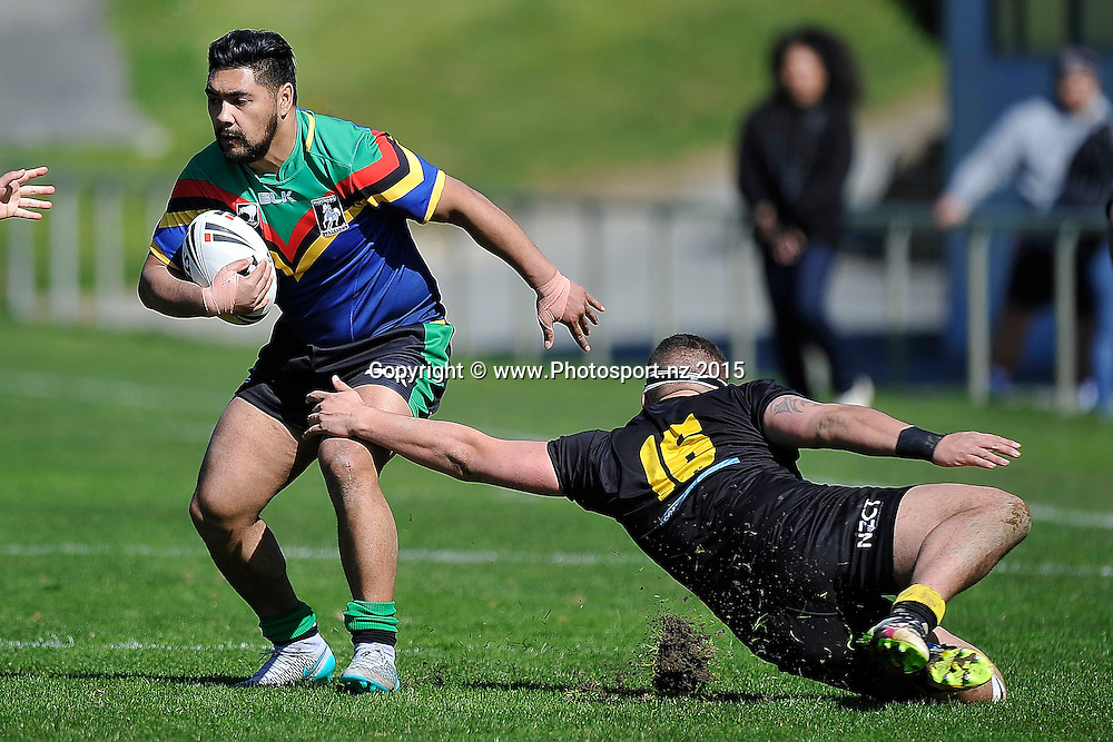 Victor Karora-Reu (L) of the Stallions is tackled by Josh Kohika-Skipper of the Orcas during the NRL National Premiership rugby league match between Wellington Orcas v Wai-Coa-Bay Stallions at Porirua Park in Wellington on Saturday the 12th September 2015. Copyright photo by Marty Melville / www.photosport.nz