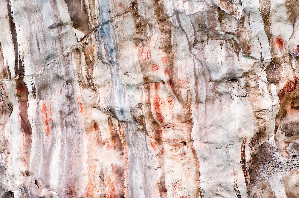 In the Misool area there are a number of sites decorated with extensive rock art or paintings.  The paintings are thought to be between 3-5000 years old and feature dolphins, fish, whales, dugong, hands, abstract figures, and what may be representations of 'Matuto', a half-man, half-lizard hero or god.  The sites are on sections of limestone cliff.