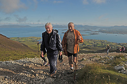 Archbishop of Tuam Dr Michael Neary with Martin Long making their way up Croagh Patrick on Reek Sunday.<br /> Photo Conor McKeown