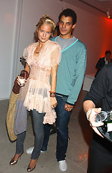MARISSA MONTGOMERY and BEN HYPOLITE at a cocktail party hosted by MAC cosmetics to kick off London Fashion Week at The Hospital, 22 Endell Street London on 18th September 2005.At the event, top model Linda Evangelista presented Ken Livingston the Lord Mayor of London with a cheque for £100,000 in aid of the Loomba Trust that aims to privide education to orphaned children through a natural disaster or through HIV/AIDS.<br /><br />NON EXCLUSIVE - WORLD RIGHTS