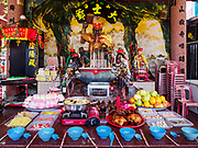 25 AUGUST 2018 - GEORGE TOWN, PENANG, MALAYSIA: An altar with food for the ghosts for the Hungry Ghost festival on the Lim Jetty on Ghost Day, the full moon day (or night) that falls in the middle of Hungry Ghost month. The Lim Jetty is one of several jetties in George Town that were created by members of Chinese clans who migrated to Penang during the British colonial period. The Ghost Festival, also known as the Hungry Ghost Festival is a traditional Taoist and Buddhist festival held in Chinese communities throughout Asia. Ghost Day, is on the 15th night of the seventh month (25 August in 2018). During Ghost Festival, the deceased are believed to visit the living. In many Chinese communities, there are Chinese operas and puppet shows and elaborate banquets are staged to appease the ghosts.   PHOTO BY JACK KURTZ