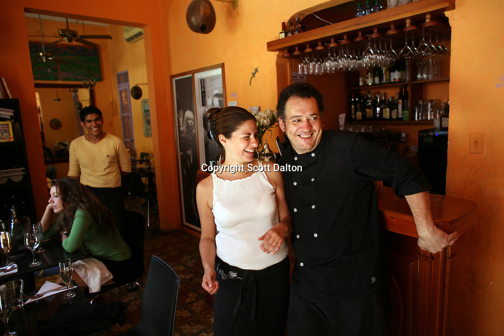 Carolina Vélez, left, and Gilles Dupart, right, at work and play, they are the proprietors of Oh! Lá Lá, a husband/wife, chef/waitress, Colombian/French duo in Cartagena on Saturday, August 23, 2008. (Photo/Scott Dalton).