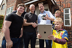 © Licensed to London News Pictures. 04/05/2015. Sutton, UK. Deputy Prime Minister, Nick Clegg speaks to supporters in Sutton as a young fan tries to take a photograph on an iPad. Photo credit : Vickie Flores/LNP