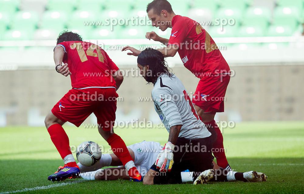 Andraz Sporar of Olimpija vs Boban Bojkovic of Crvena Zvezda during friendly football match between NK Olimpija Ljubljana and Crvena Zvezda (Belgrade), on June 27, 2012 in SRC Stozice, Ljubljana, Slovenia. (Photo by Vid Ponikvar / Sportida.com)